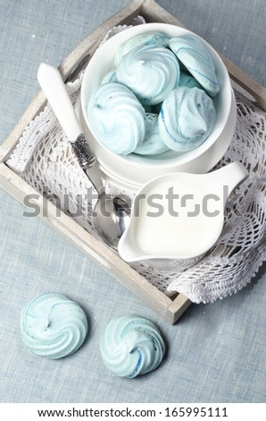 Azure homemade meringue cookies and cup of milk From series Christmas and New Year - stock photo