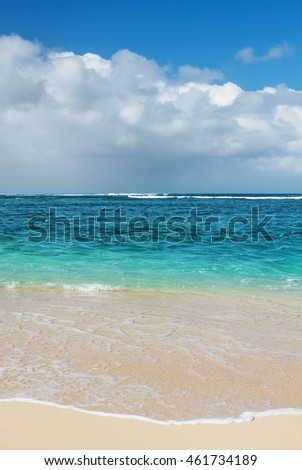 Azure ocean wave and blue sky with clouds, beach background