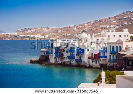Azure waves with white sea foam around Little Venice on Mykonos. Greece - stock photo