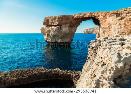 Azure Window, famous stone arch of Gozo island in the sun in summer, Malta. - stock photo