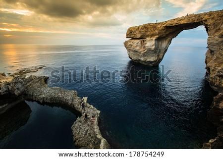 Azure Window, natural arch on Gozo island, at sunset - stock photo