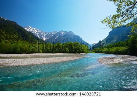 Azusagawa River and Peaks of the Hotakas. This image was taken in Kamikochi, Nagano Prefecture, Japan  - stock photo