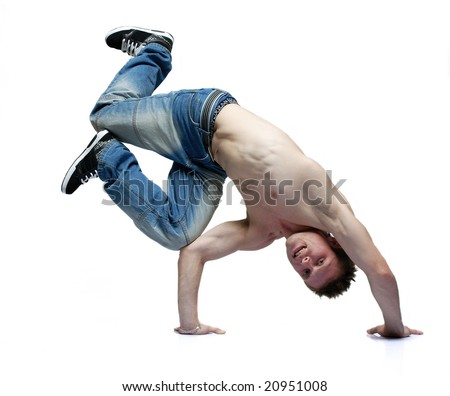 B-boy dancer making a flip standing on his hands knees bent looking at the camera