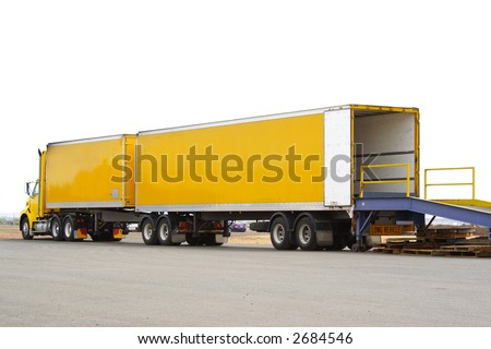 B double truck backed onto loading dock with white background - stock photo