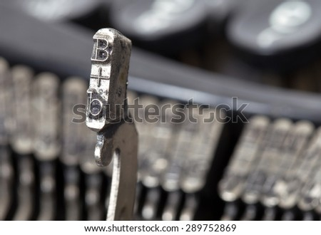 B hammer for writing with an old manual typewriter - stock photo