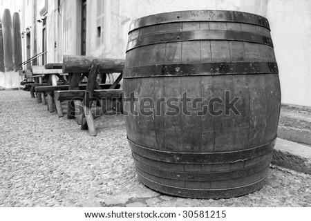 B&W Barrel outdoor, next to local pub. - stock photo