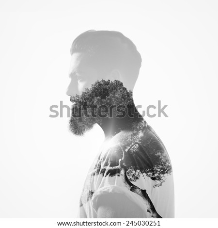 B/w double exposure portrait of a bearded guy and tree - stock photo