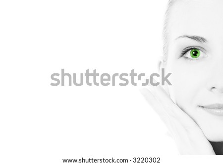 B&W girl's face with a green eye lens - stock photo