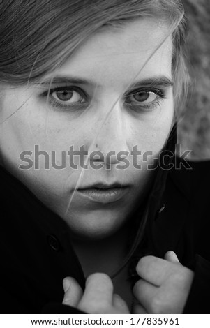 B&W image of a young woman in despair or worry. - stock photo