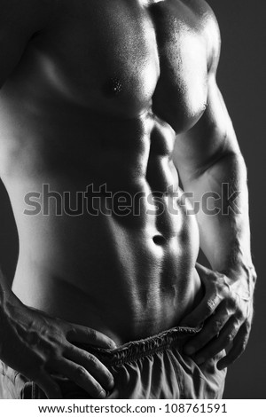 B&W Muscular male torso isolated on black
