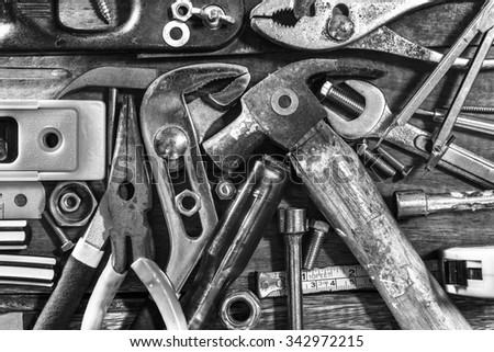 B&W old & grunge set of hand tools on wood floor for home renovation background