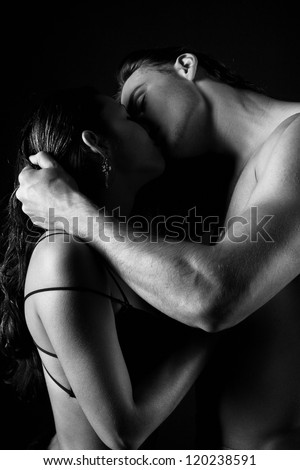 B&W photo of passionate married couple - stock photo
