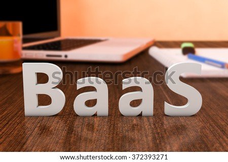 BaaS - Backup as a Service - letters on wooden desk with laptop computer and a notebook. 3d render illustration.