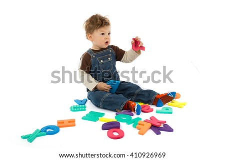 babay plays with letters