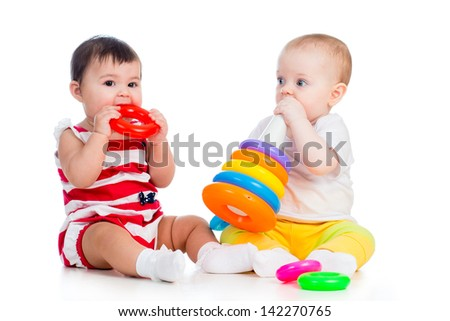 babies girls playing toy together - stock photo