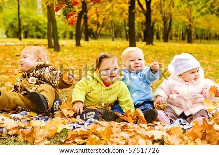 Babies group having fun in fall - stock photo