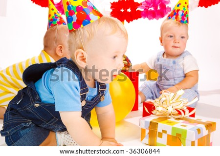 Babies having fun at the birthday party - stock photo