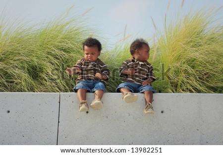 Babies on a Ledge - stock photo