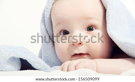 baby after bath under a blanket - stock photo