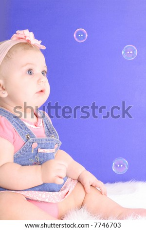 baby amazed with bubbles - stock photo