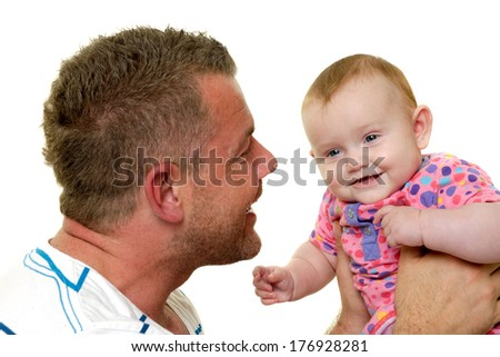 Baby and father are playing. They are both smiling and are very happy together.  The baby 3 month old. Isolated on a white background.