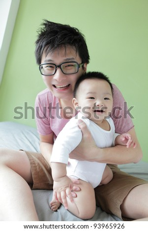 Baby and Father Happy Smile Face with green home background, Model are asian family - stock photo
