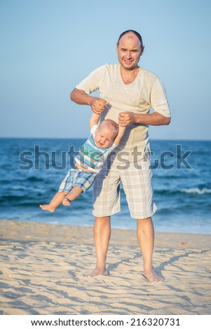 Baby and father having fun time  - stock photo