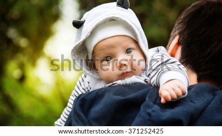 Baby and father on nature  - stock photo