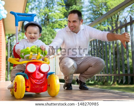 baby and father playing outdoor - stock photo
