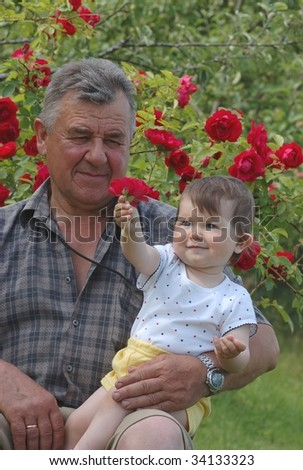 Baby and grandfather - stock photo