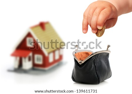 Baby and house. Invest in real estate. - stock photo