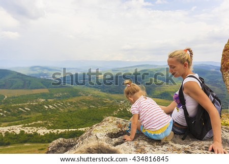 Baby and mommy on the edge - stock photo