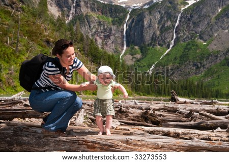 Baby and mother have their first hike - stock photo