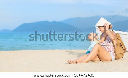 Baby and mother outdoor portrait - stock photo