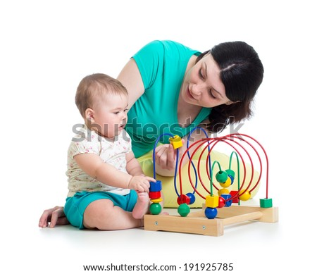 baby and mother play with color educational toy - stock photo