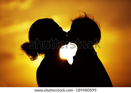 Baby And Mother Silhouettes - stock photo
