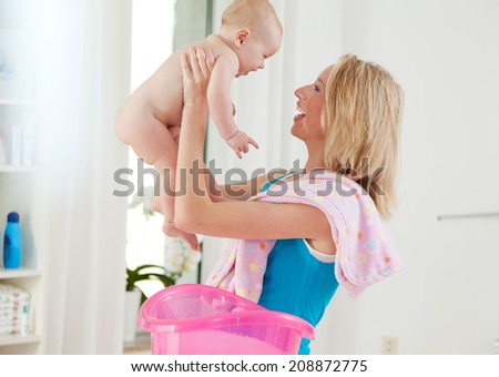 baby and mother washing - stock photo
