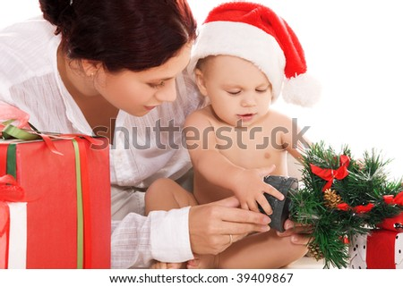 baby and mother with christmas gifts over white (focus on boy) - stock photo