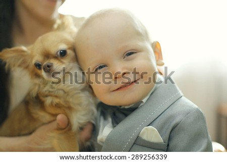 baby and small dog - stock photo