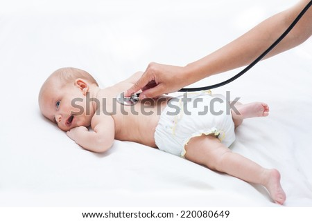 baby and stethoscope over white background - stock photo