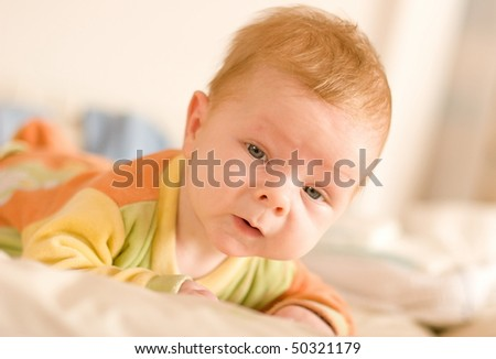 baby at six months crawling and playing indoor - stock photo