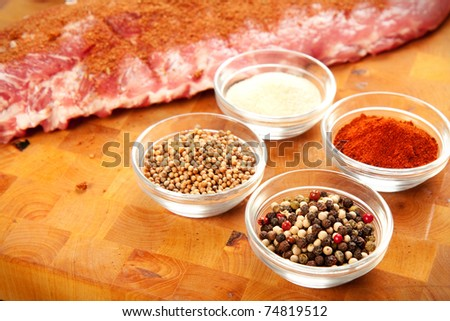 Baby back rib presented with common spices used for rub seasoning - stock photo