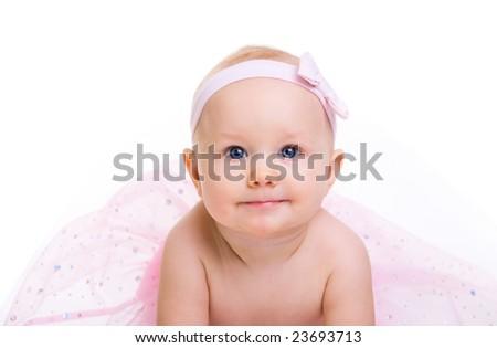 Baby Ballerina. Very cute happy baby girl wearing ballerina skirt. Isolated on white. - stock photo