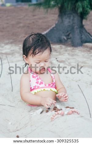 baby beach sand playing summer - stock photo