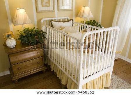 Baby bedroom with a crib, toys and decor. - stock photo