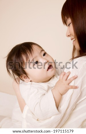 Baby Being Embraced By Mother