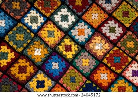 Baby blanket of granny squares - stock photo