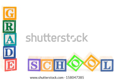 Baby blocks spelling grade school isolated on a white background - stock photo