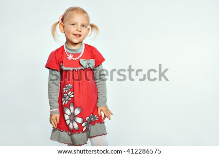 Baby blonde girl on a white background. Girl grimaces - stock photo