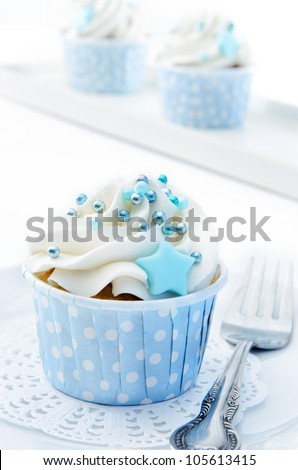 Baby blue and white theme cup cakes served with vintage fork - stock photo